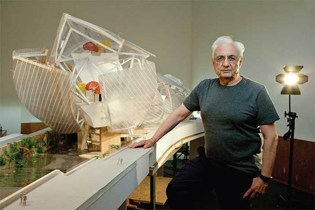 """Frank Gehry with a model of the Fondation Louis Vuitton—""""it looked like a regatta to me"""". (The Art Newspaper; Photo: © Sébastien MICKE/PARISMATCH/SCOOP)"""