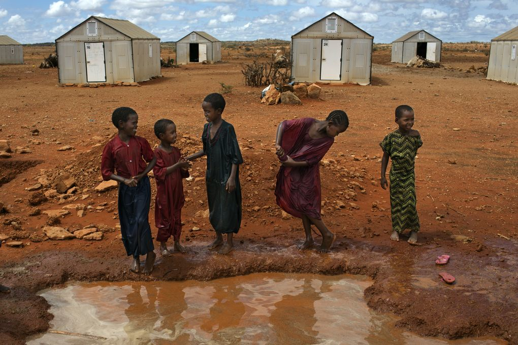 """Families in front of """"Better Shelters"""" at the Hilawyen refugee camp in Dollo Ado, Ethiopia."""