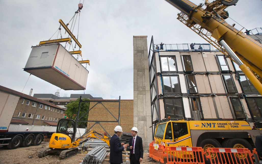 Construction workers installing modular flats for an estate regeneration project in Lambeth (Credit: Heathcliff OMalley)