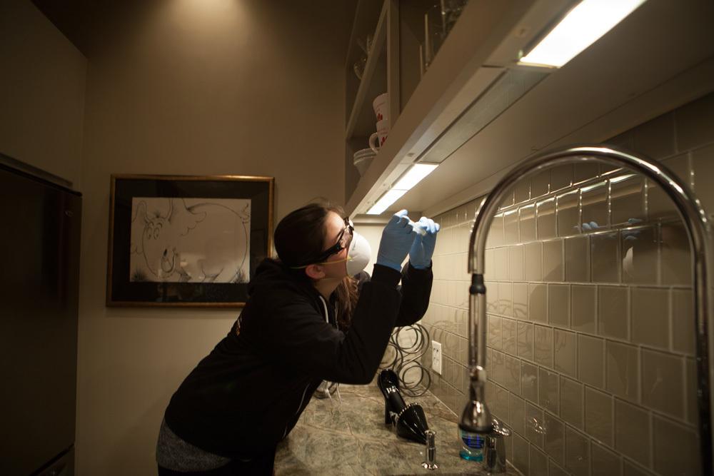 Taking samples in kitchen.