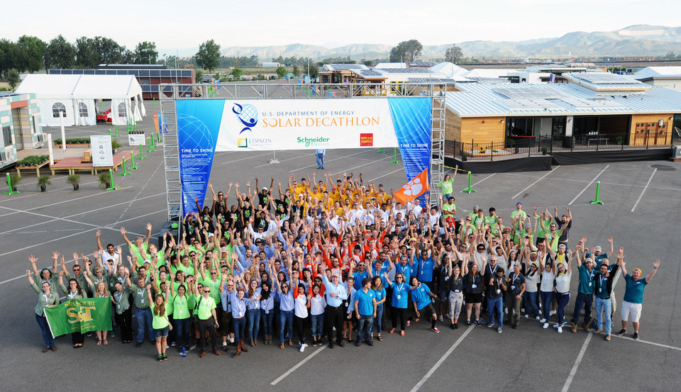 The competing teams pose for a group shot on opening day of the U.S. Department of Energy Solar Decathlon. (Credit: Thomas Kelsey/U.S. Department of Energy Solar Decathlon)