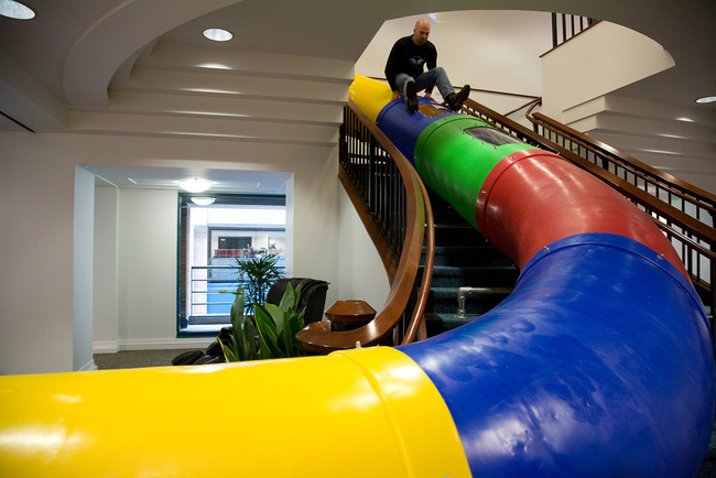 Slide at Googles SF office. Via flickr/Scott Beale.
