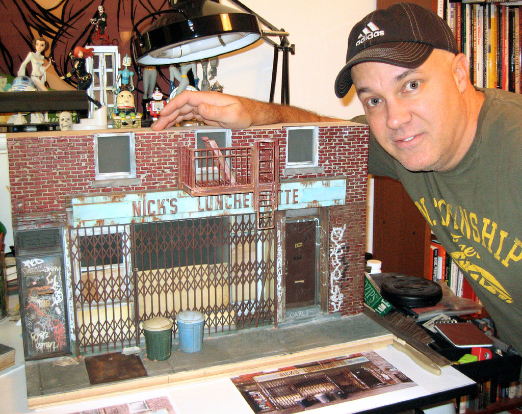 Randy Hage with scale model of Nicks Luncheonette,now closed, at 196 Broadway in Brooklyn