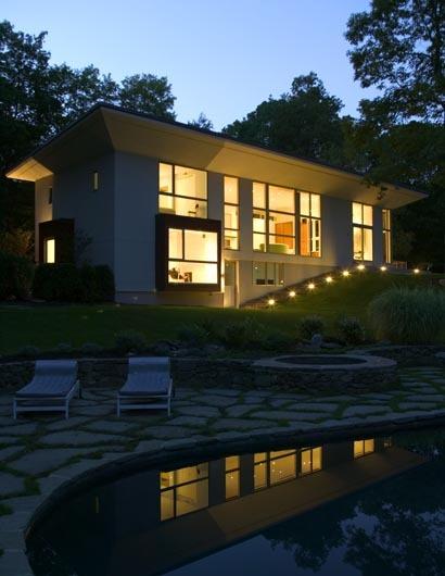 pool and rear facade at dusk