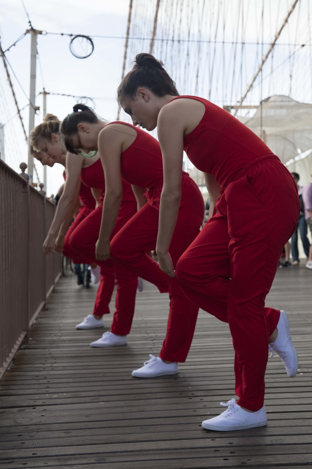 While crossing the Brooklyn Bridge, Rick Moody encountered dancers Kristin Swiat, Giovanna Gamna, Lydia Chrisman, Maya Orchin, Jessica Myers, and Annie Saeugling performing choreography by Jen Harmon for When I Left the House it was Still Dark in New York City in 2013. Photograph by Ayden L.M...