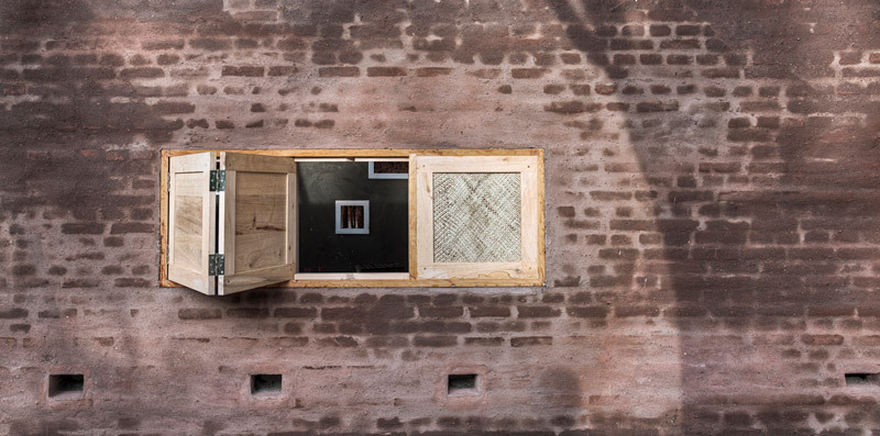 Handmade window from cinnamon wood (Photo: Pasi Aalto / pasiaalto.com)