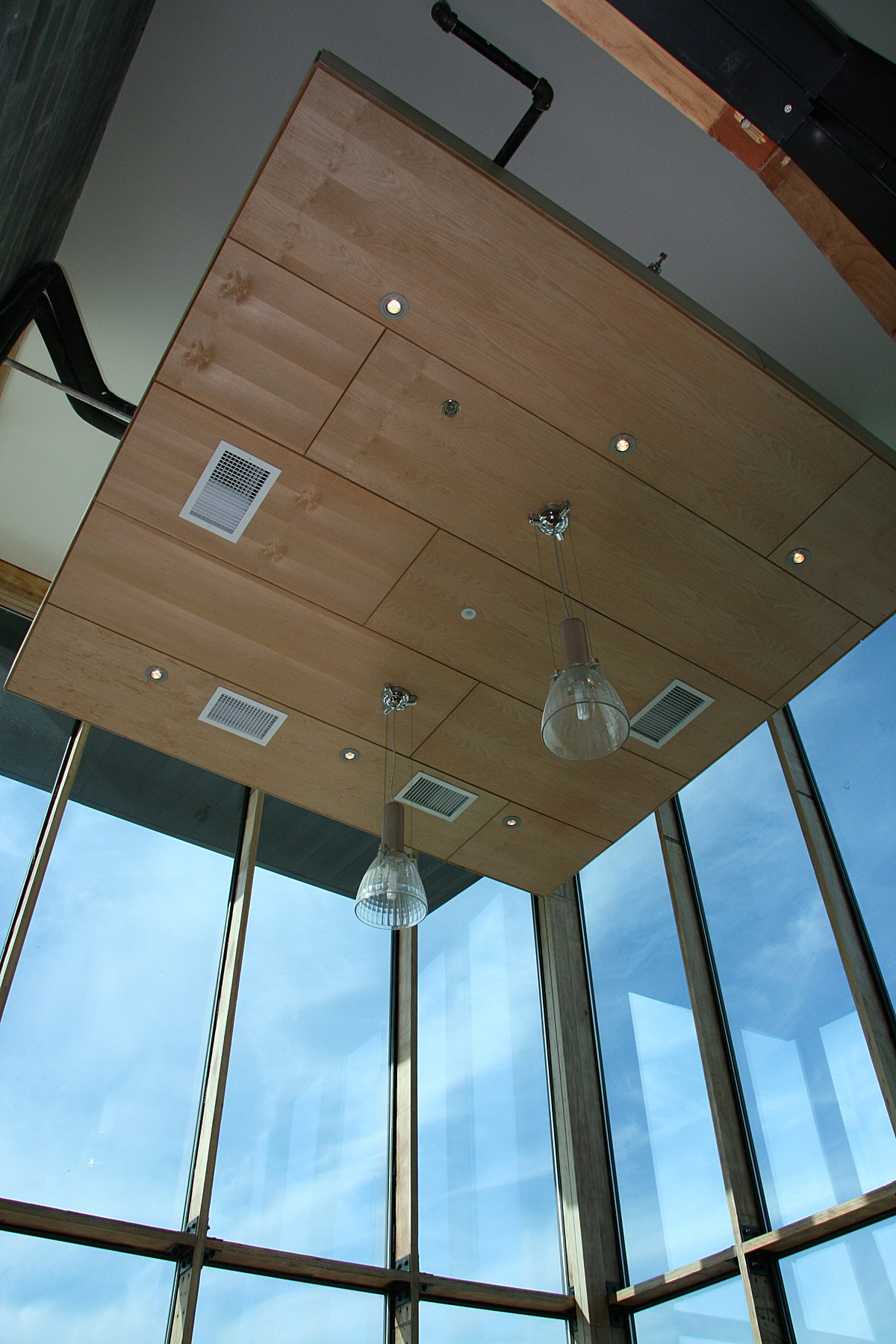 The clearstory of The Green Building is used as an office conference room. The glass has 30% recycled content and the aluminum frame around each window has 70% recycled content.