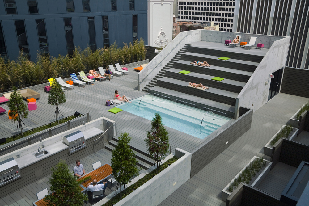 Pool deck and aerial view of townhouses with private decks.