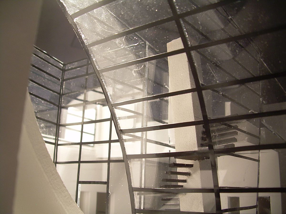 Inside the entrance space looking at the interior glass facade and stair case.