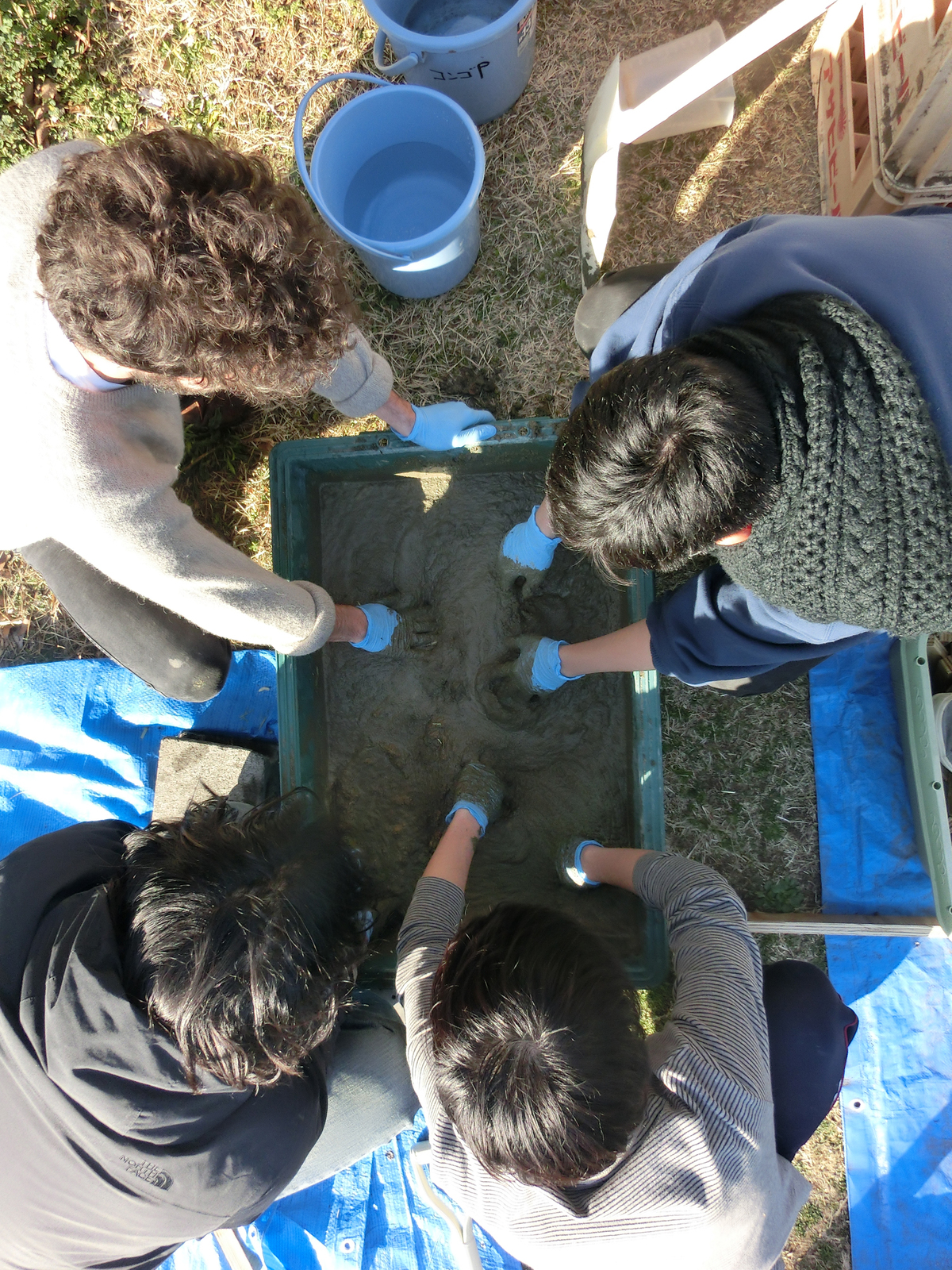Testing concrete mixes at the Keio workshop. Courtesy of Bill Galloway.