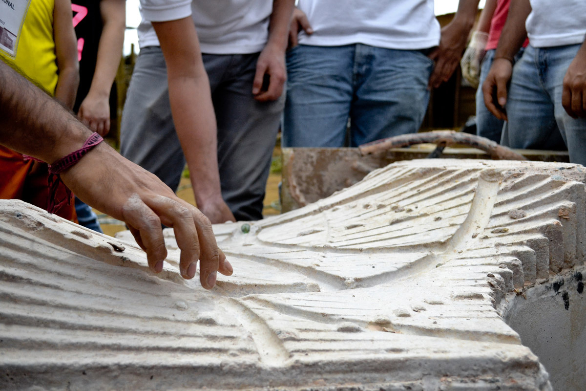 Students playing with some marble on the built prototype