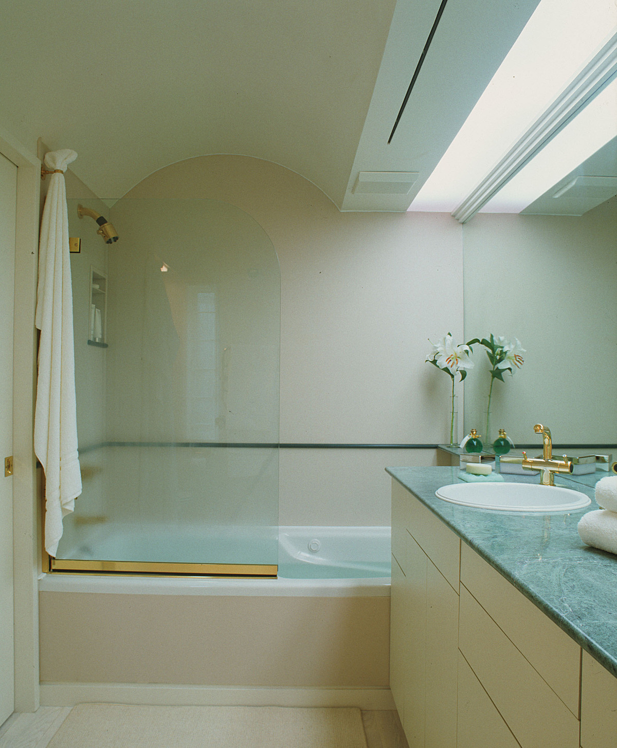 Tub and shower with glass screen.
