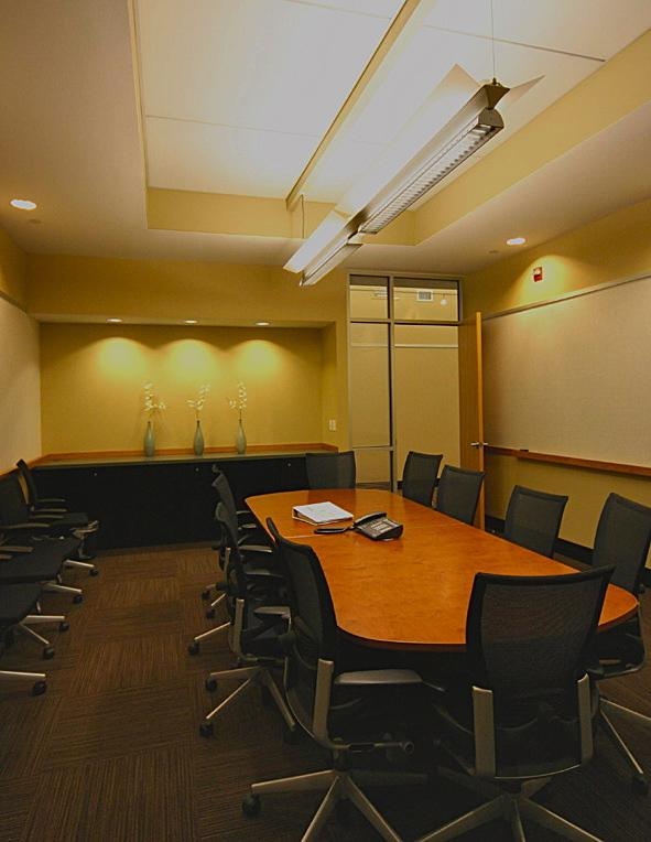 Conference room enclosure inside auditorium volume