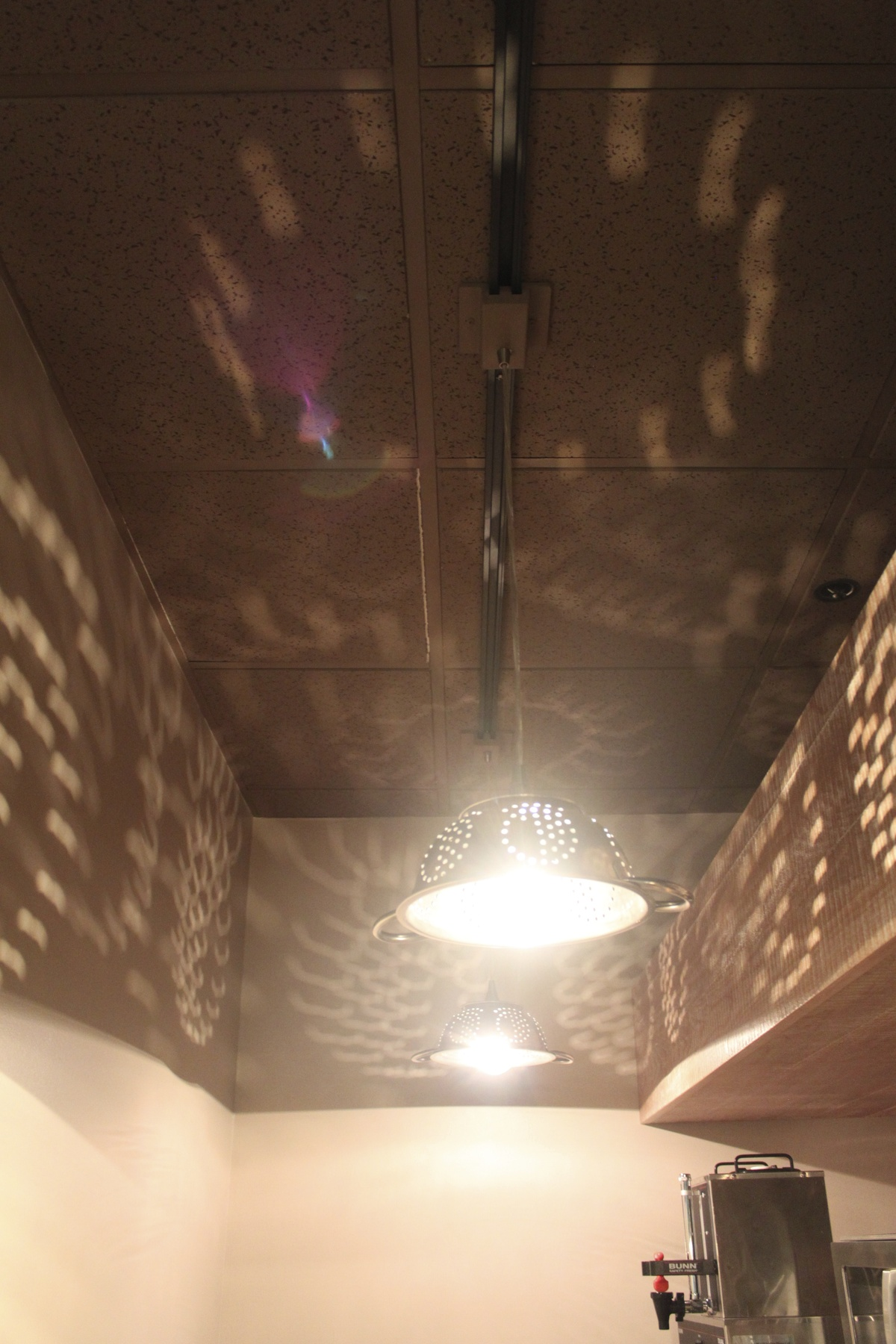 I designed colander lights for the heating and condiment section.