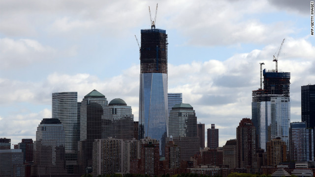 After beams are placed on top of the 100th floor of the One World Trade Center tower, center, it will become New York City's tallest building.