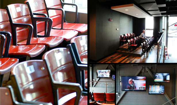 Fenway park style seating, overlooks television screens displaying sports games