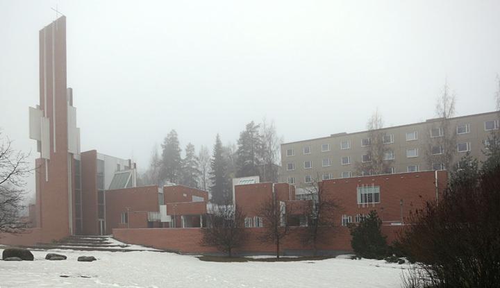 A haze shrouded Männistö Church by Juha Leiviskä in Kupio, Finland.