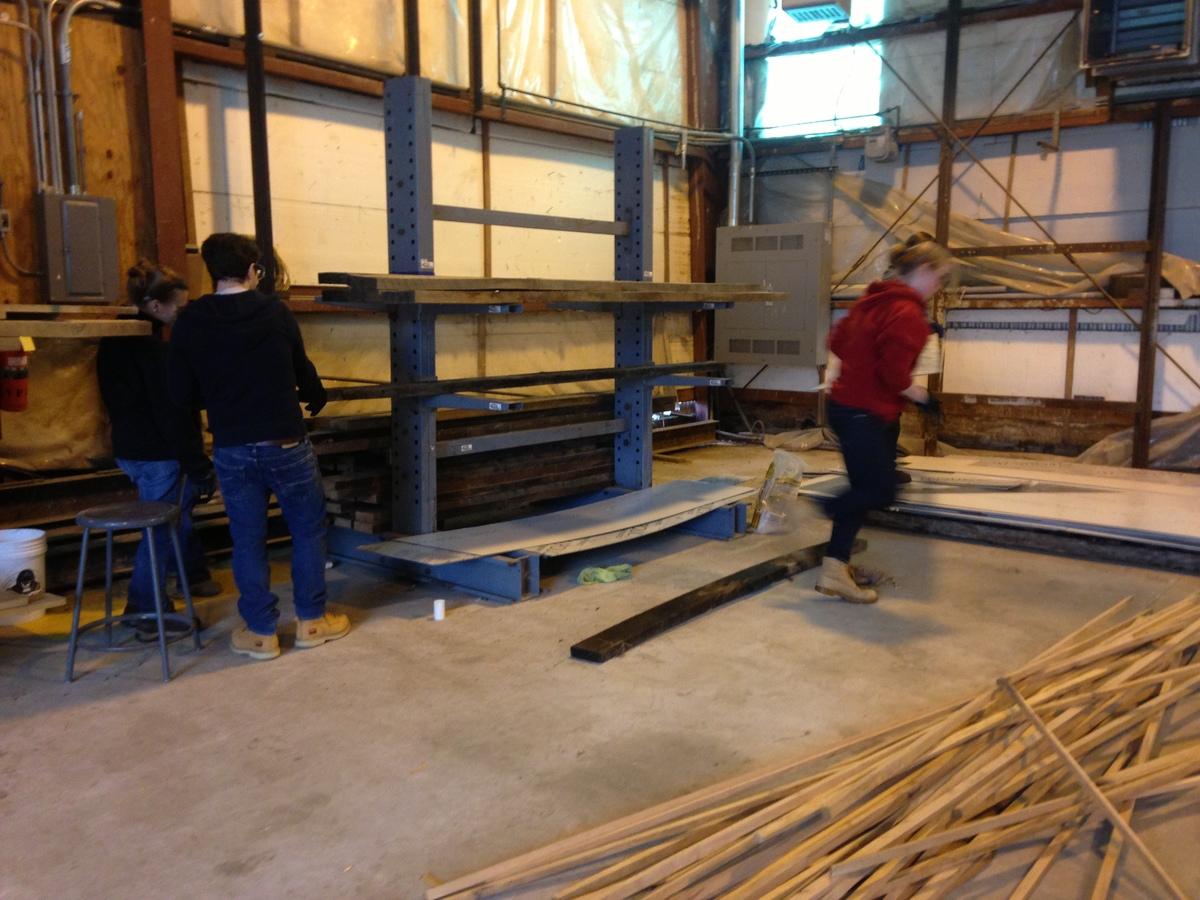 Bryana and Michael sort wood