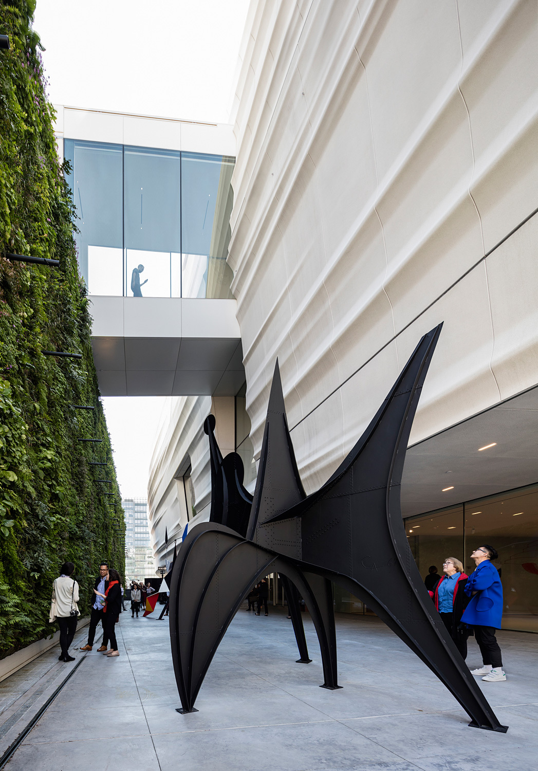 Pat and Bill Wilson Sculpture Terrace featuring Alexander Calder's sculpture Maquette for Trois Disques (Three Disks), formerly Man (1967) and the living wall, designed by Habitat Horticulture; photo: © Henrik Kam, courtesy SFMOMA.