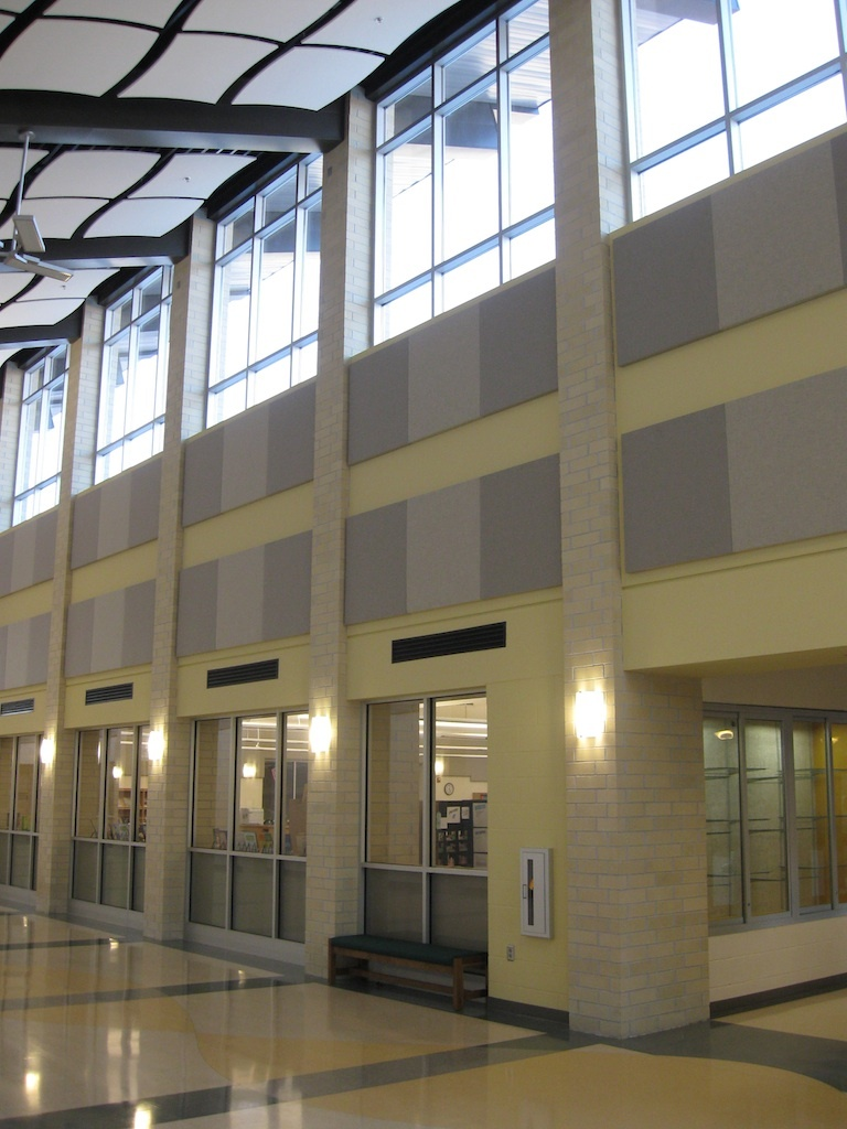 Main corridor linking student classroom wings and entrance.