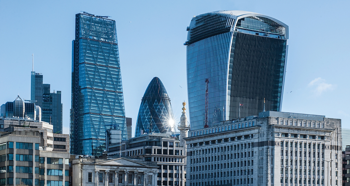 Fame and popular nicknames: Rafael Viñolys Walkie Talkie next to Norman Fosters Gherkin. (photo via chtmag.com)