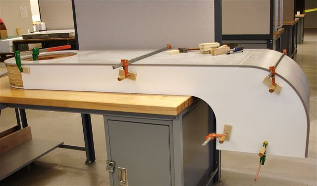 cladding thermoformed Corian and PVC foam board onto arms