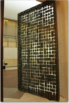 One of the thousand pound bronze and glass doors that open into the light court from the Collection Galleries. (MICHAEL BRYANT : Staff Photographer )