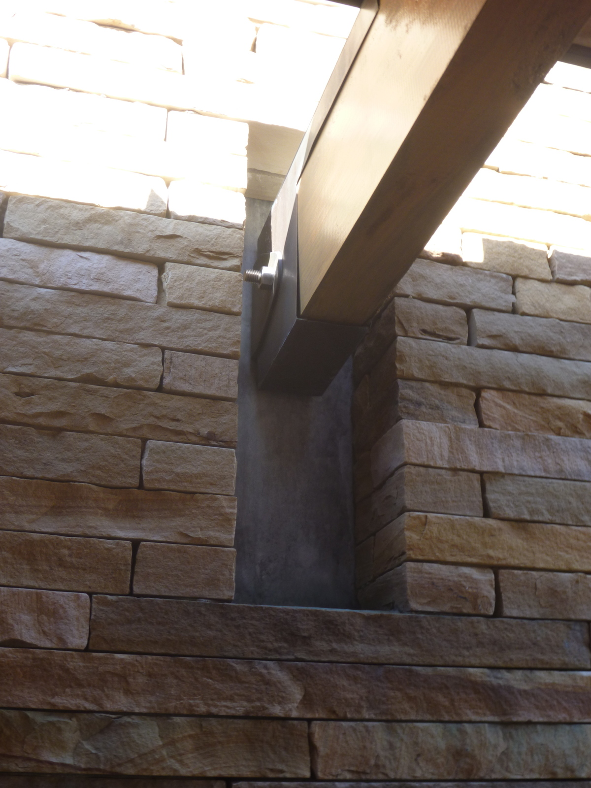 How the wooden beams meet the stone wall