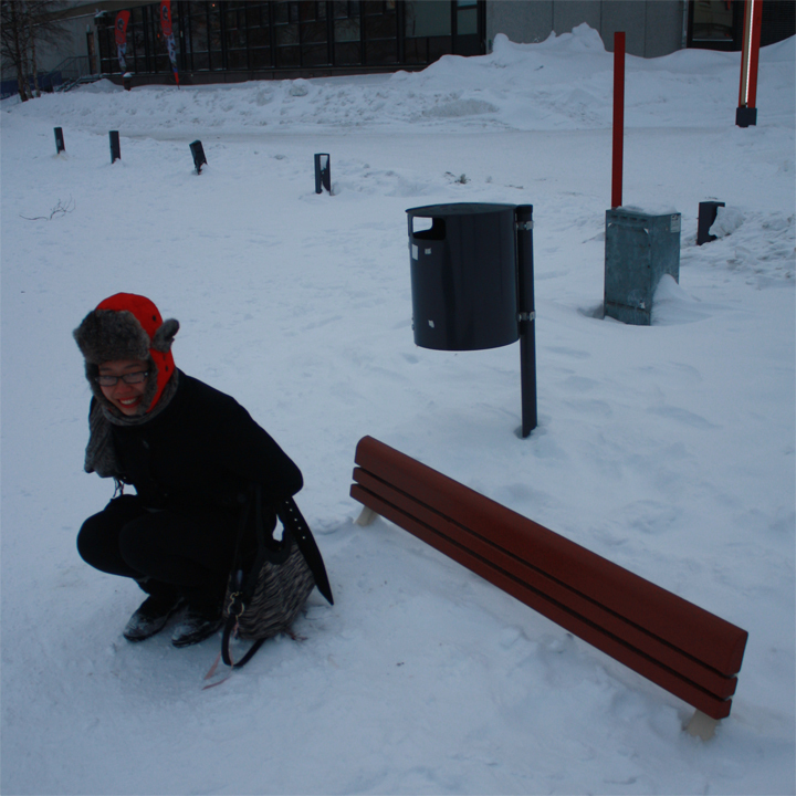 Jennifer Wong in relationship hidden park bench buried in snow.