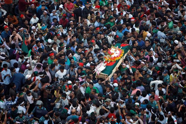 Mourners in Bangladesh on Saturday carried the coffin containing the body of Rajib Haider, an organizer who was killed.