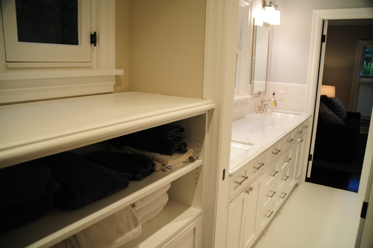 A closet was shifted to create a vestibule into a new Jack-&-Jill bathroom.