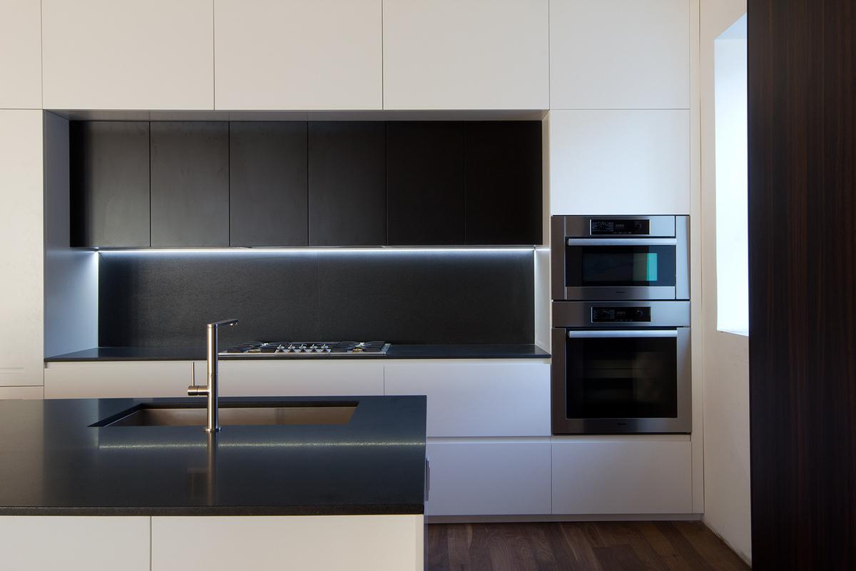 GLAM Kitchen: smooth matte gray Lacquer and CaesarStone quartz countertop.