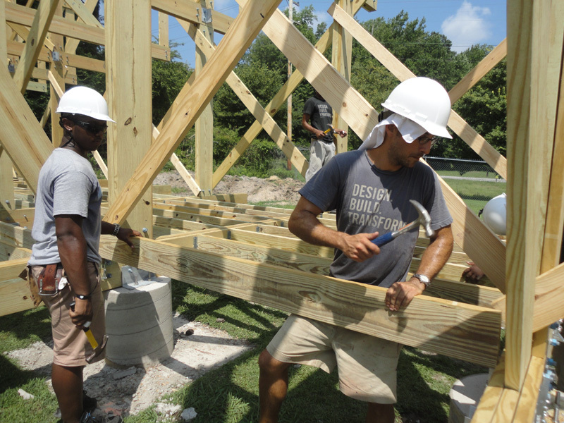Studio H student Erick Bowen and instructor Matthew Miller work on constructing the Windsor Farmers Market pavilion. From IF YOU BUILD IT, a Long Shot Factory Release 2013.
