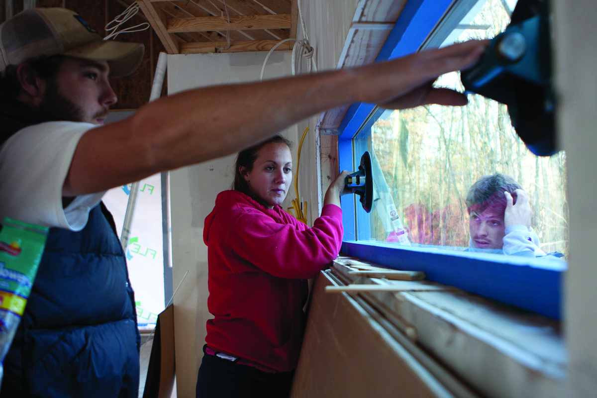 Students installing custom-made windows
