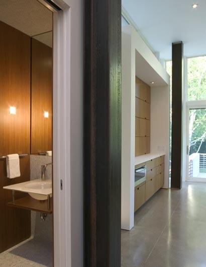 powder room with kitchen beyond