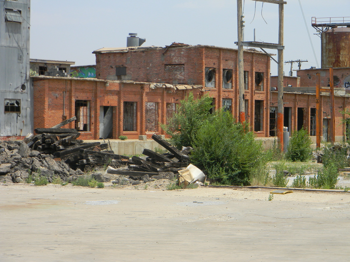 current decay of the site; a cotton industry site, not used anymore