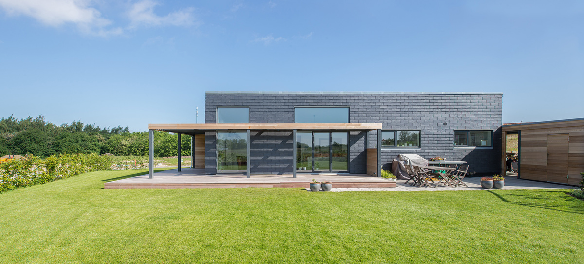 Sustainable slate tiles dress this danish family s energy for Energy efficient green homes