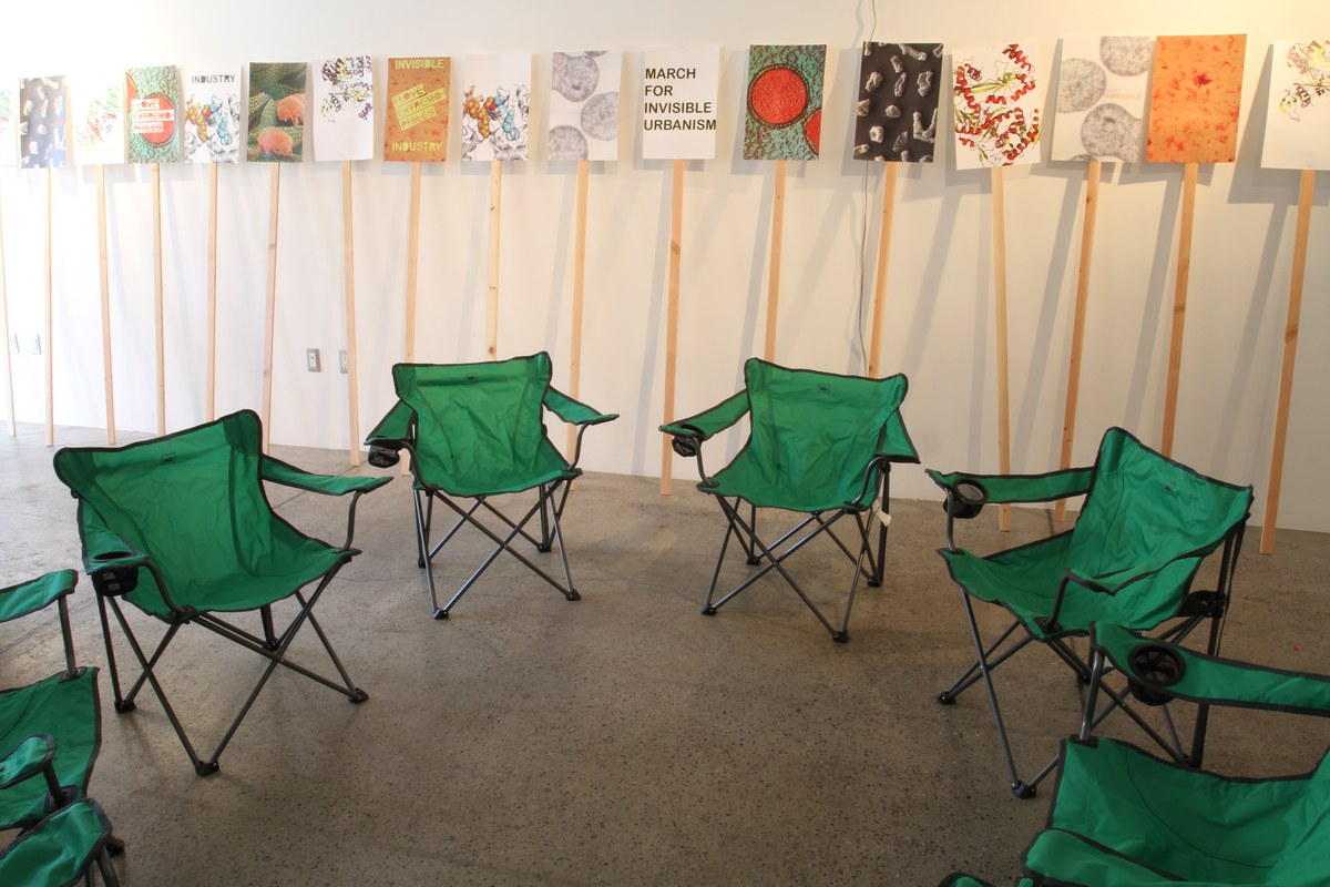 Camp chairs and picket-signs set up for GRNASFCKs exhibition I love extremophiles! Credit: GRNASFCK