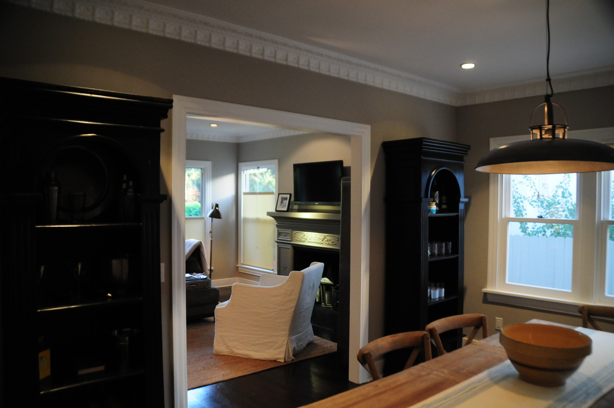 Restoring the fireplace surround, moulding and original hardwood floors kept that bungalow feel.