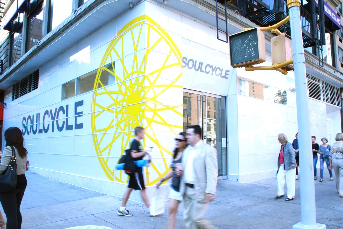 branded storefront signage and new exterior storefront to match existing