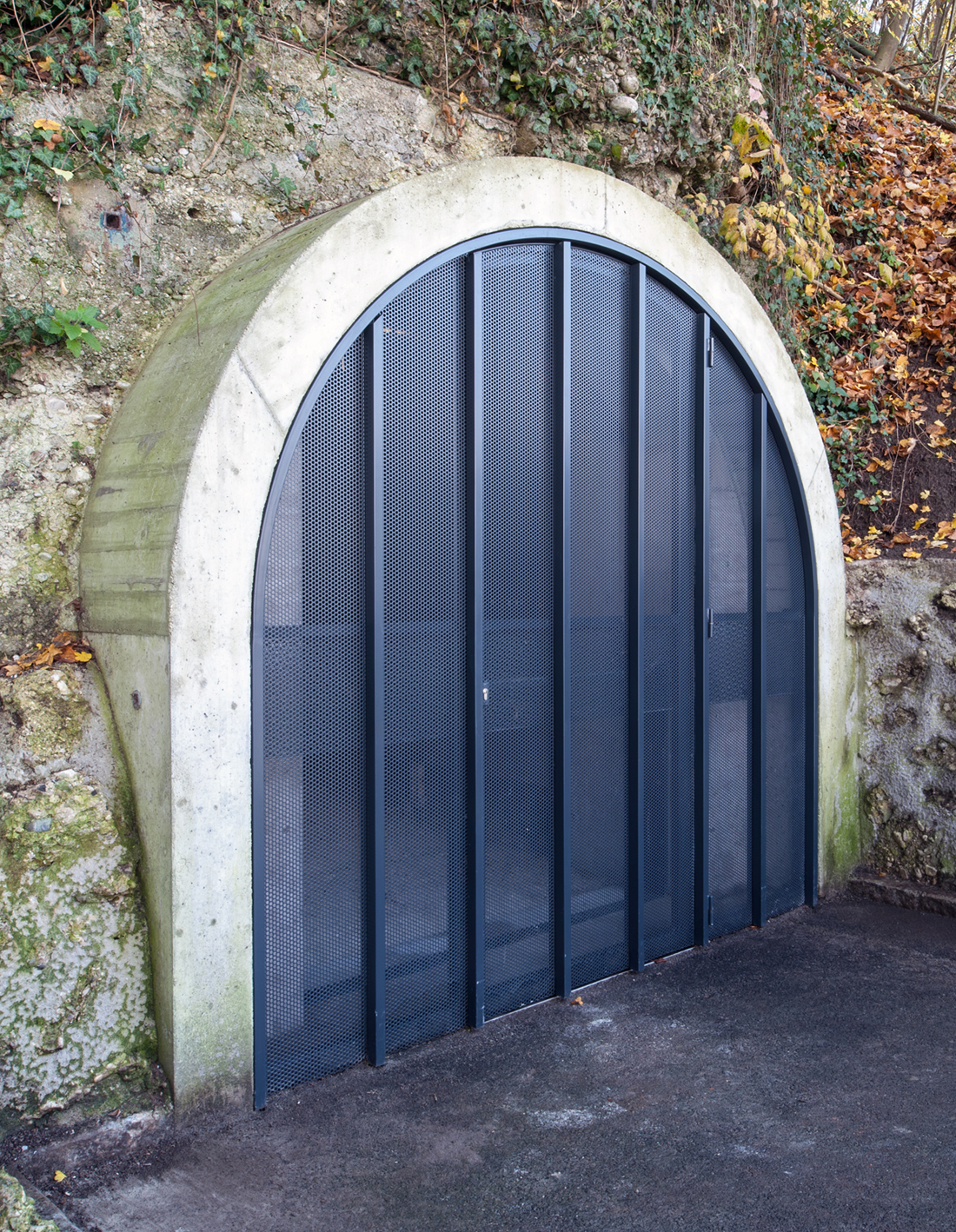 Gate 2: When closed the gates form translucent walls that close off the tunnel from the outside. There are no door handles or visible entry signs.