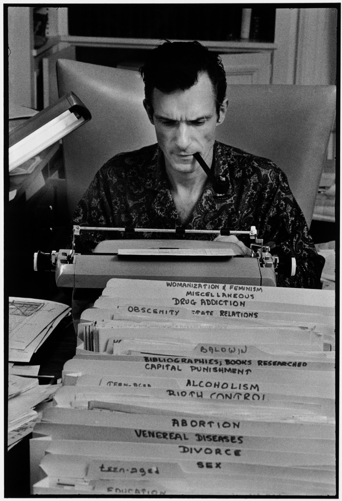 Hugh Hefner at work. Image courtesy Elmhurst Art Museum.