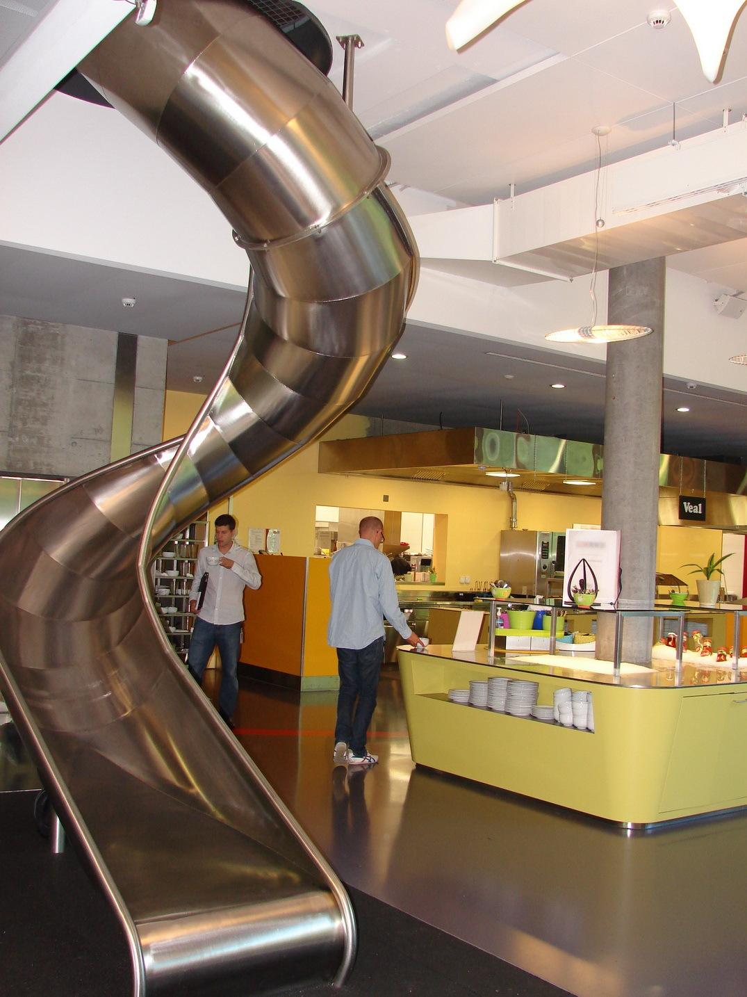 Google Zurich's slide-cafeteria. Image via Yale Computer Science.