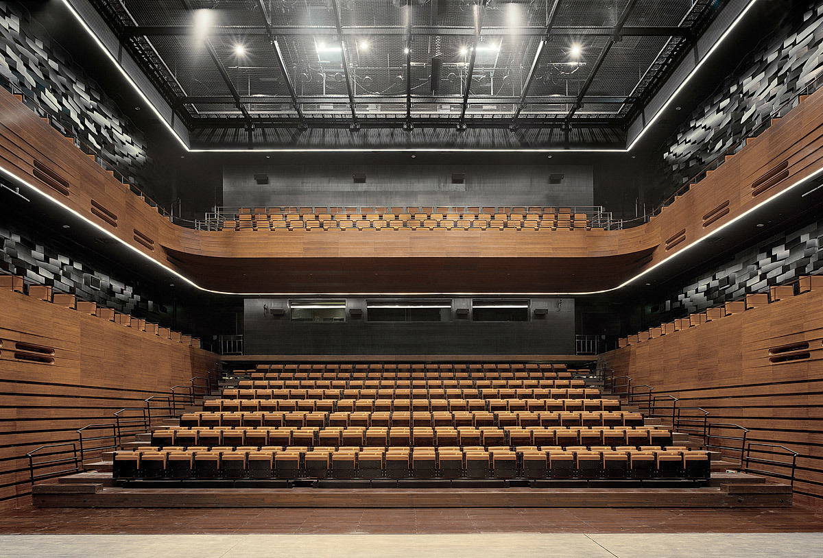 The small auditorium as seen from stage. The 700 seats are partly retractable to enable a multifunctional usage of the space. (Photo: Jussi Tiainen)