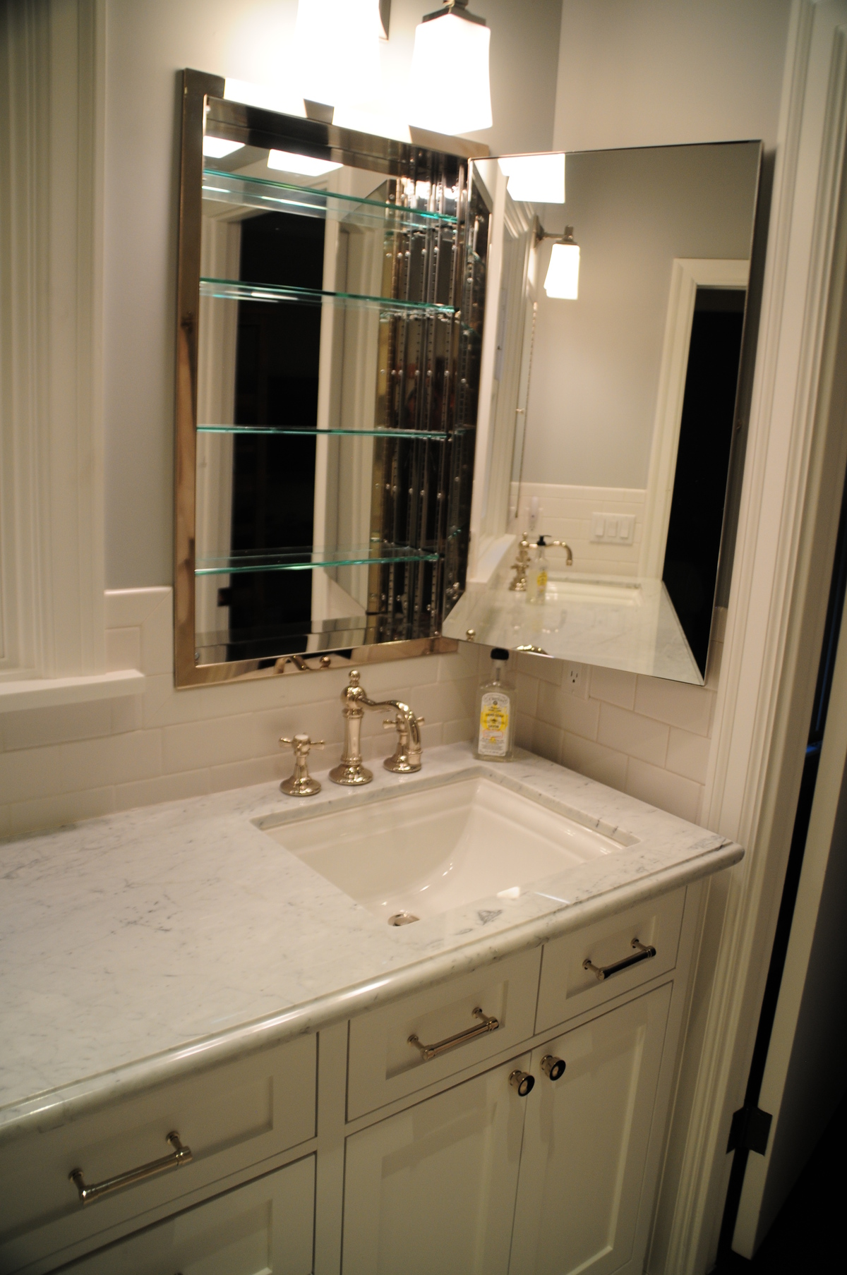 An additional sink with new medicine cabinets created more storage.