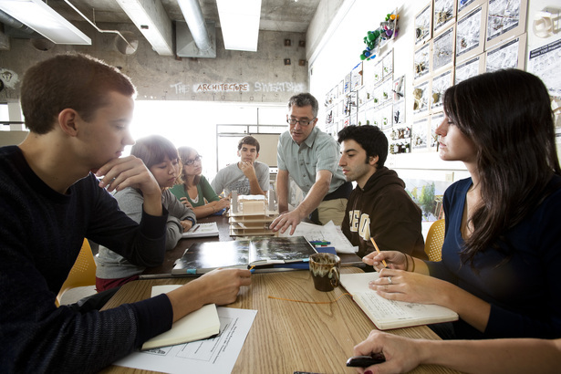 The University of Oregons Associate Dean Brook Muller works with UO architecture students on a studio design project that aligns urban redevelopment and improved ecological function