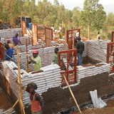 The first EarthBag house under construction in Masoro Village, Rwanda. Photo via Masoro Project Indiegogo page.