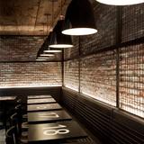Tartinery Nolita in New York, NY by SOMA Architects (interior design); Caravaggio P2 Black pendants by Lightyears