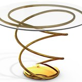 A double-spiral side table finished in 24K gold. Photo courtesy of Pollaro Custom Furniture