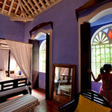 A room at Quelleachy Gally, a restored Indo-Portuguese home that's now an inn. Credit Kuni Takahashi for The New York Times